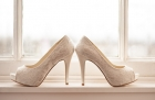 18976951 - high healed wedding shoes on a windowsill by a window