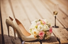 23107049 - close up of wedding bouquet and bride shoes
