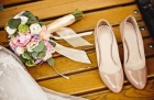 24045184 - close up of wedding bouquet and bride shoes