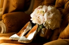 87873715 - bridal bouquet with wedding shoes