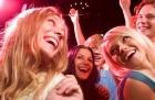 Several smiling dancers having fun during disco